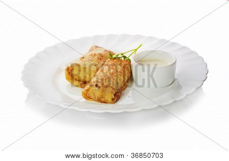 Fresh hot pancakes on a plate on a white background
