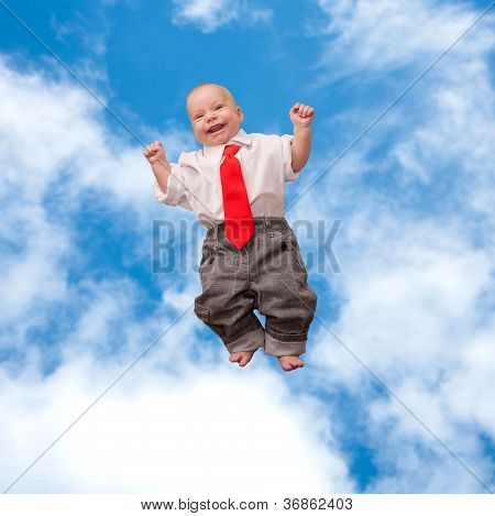 newborn baby smiling flying up