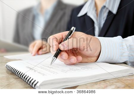 Male Hand with Pen at the Meeting