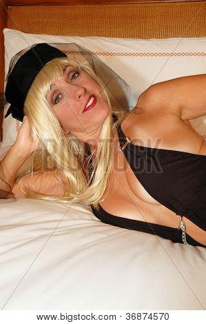 blond in pillbox hat