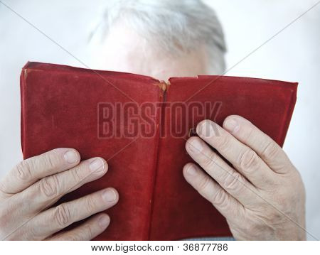 older man reading a book