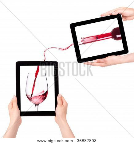 Hands Holding Digital Tablet With Red Wine Splashing