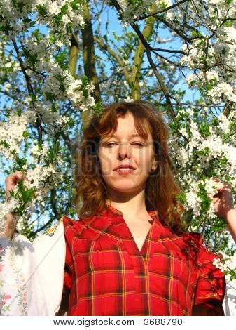 Red-Haired Girl In Garden