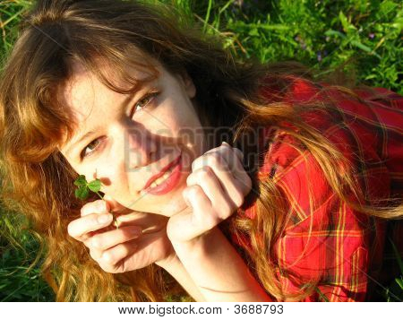 Redhaired Girl With Clover