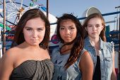 image of bff  - Trio of serious teenage girls at an amusement park