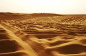 stock photo of saharan  - Panoramic view of Jeeps on the dunes of Sahara desert - JPG