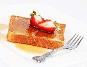 stock photo of french toast  - French toast with maple syrup and strawberries - JPG
