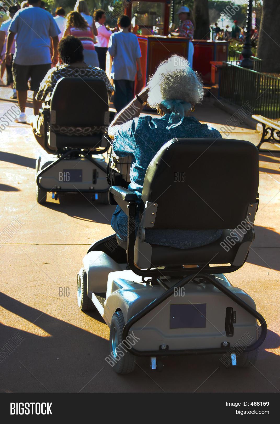 Seniors On Motorized Scooters Stock Photo Stock Images