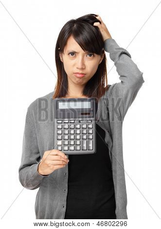 Worried woman holding calculator