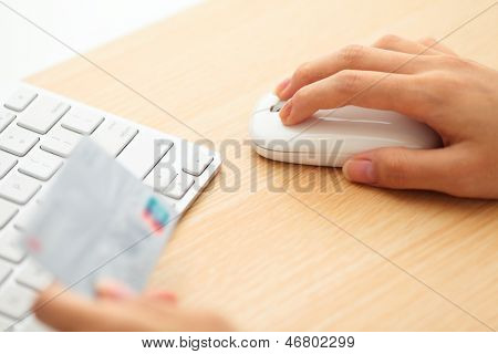 Online shopping with credit card and keyboard