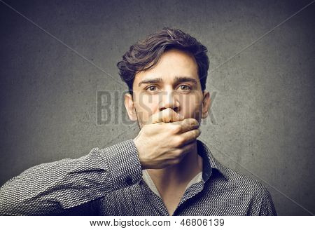 silent man with hand on mouth
