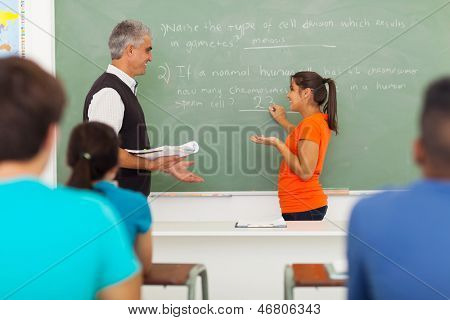 senior high school teacher teaching biology class