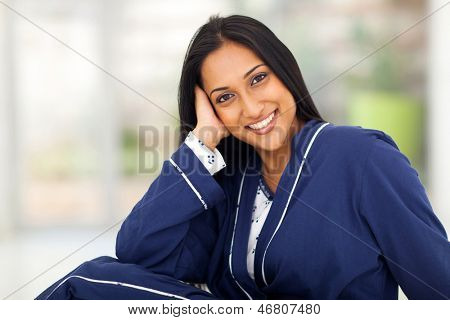 portrait of young indian woman in pajamas at home
