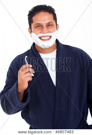 smiling indian man shaving face isolated on white background