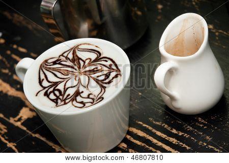 coffe espresso compano cup on the black background