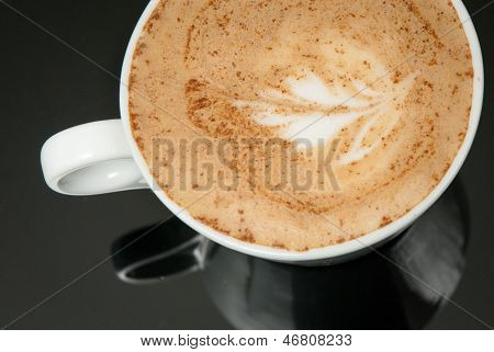 white coffe cup on the black background