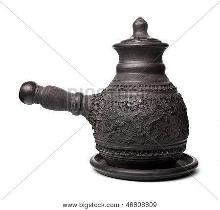 Black clay pot on a white background.