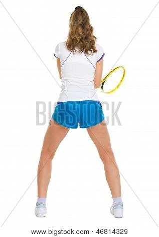 Female Tennis Player In Stance . Rear View