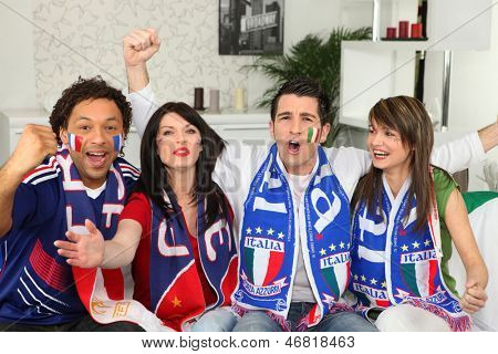 Italian football supporters watching match from home