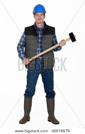 Man with sledge hammer ready to work