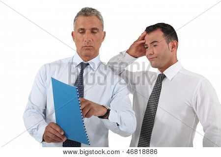 Boss explaining mistake to employee