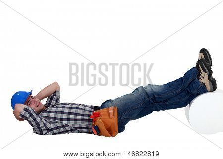 Construction worker lying down with his feet up