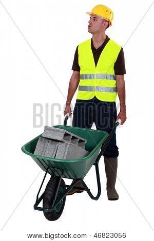 Mason pushing wheelbarrow
