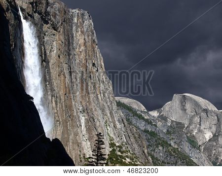 Spring storm cloud and with Yosemite Falls and Half Dome..