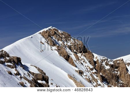 Top Of Mountains With Snow Cornice