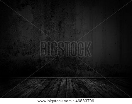 Dark wall and floor stage background.