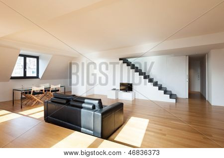 Interior, wide loft, hardwood floor, view living room