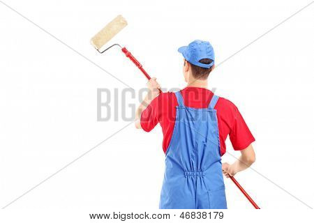Man in a uniform painting a wall, isolated on white background