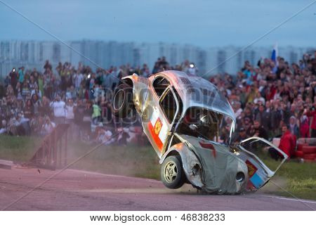 MOSCOW - AUG 25: The car landed after jumping from the springboard on Festival of art and film stunt Prometheus in Tushino on August 25, 2012 in Moscow, Russia. The festival was organized in 1998.