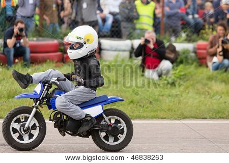 MOSCOW - AUG 25: Kid on motorcycle stunt shows on Festival of art and film stunt Prometheus in Tushino on August 25, 2012 in Moscow, Russia. The festival was organized in 1998.