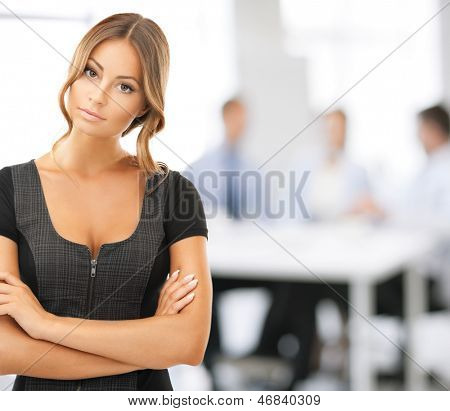 bright picture of attractive businesswoman in office