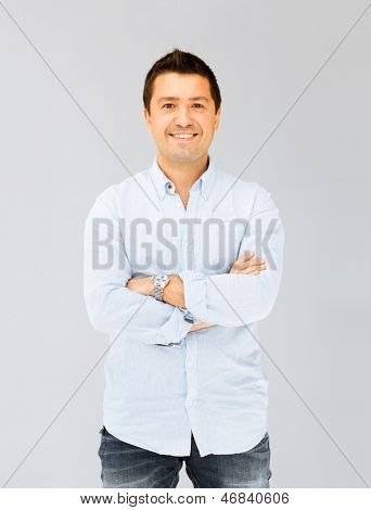 portrait of handsome smiling man in casual shirt