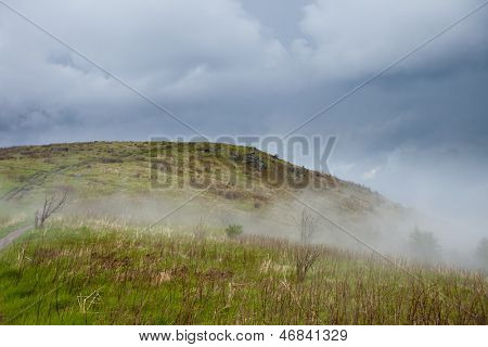 path through the fog over mountaintop