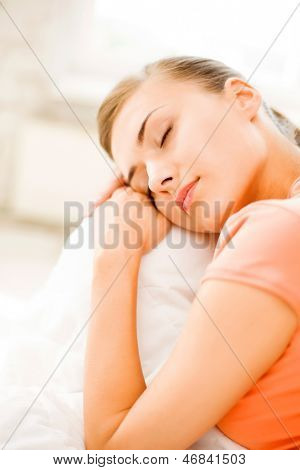 brigh picture of woman sleeping on the couch at home