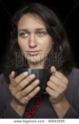 Young Woman With Beautiful Green Eyes Drinking Coffee