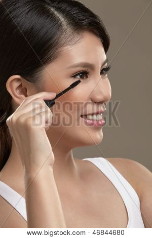 Female Asian Applying Mascara