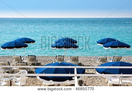 Lounge Chairs And Parasol