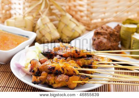 Chicken satay, ketupat or malay rice dumpling, lemang, rendang. Traditional Malay food, ramadan dish. Malaysian cuisine.