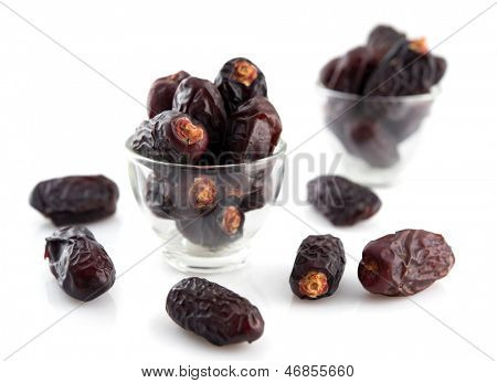 Dried date palm fruits or kurma, ramadan food which eaten in fasting month, isolated on white background.