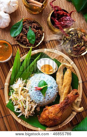 Traditional Malaysian food, Asian cuisine. Nasi kerabu is a type of nasi ulam, popular Malay rice dish. Blue color of rice resulting from the petals of  butterfly-pea flowers
