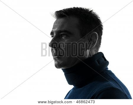 one caucasian man with cervical collar neckache  portrait in silhouette studio isolated on white background
