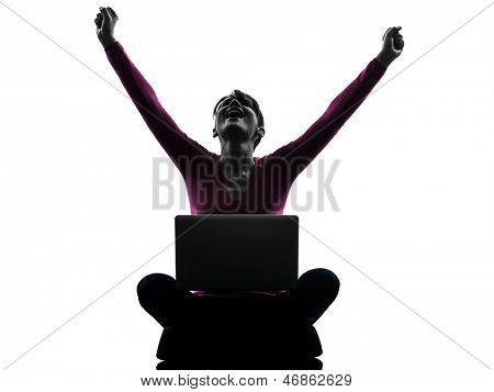 one caucasian woman happy winning  computing laptop computer  in silhouette studio isolated on white background