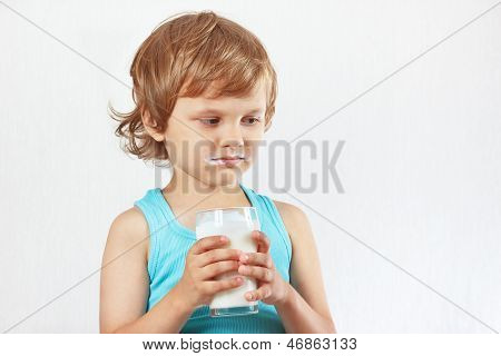 Unhappy child does not want to drink fresh milk