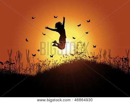 Silhouette of a woman jumping against a sunset background with grass and flowers