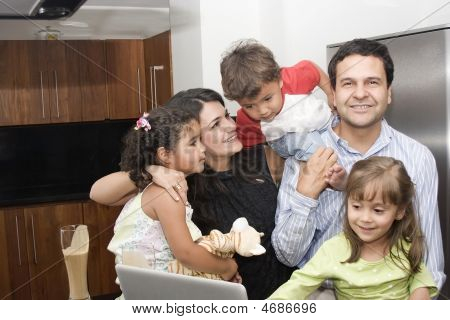 Portrait Of Beautiful Family Cooking In Kitchen
