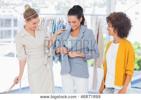 Beautiful woman wearing a blazer in a creative office